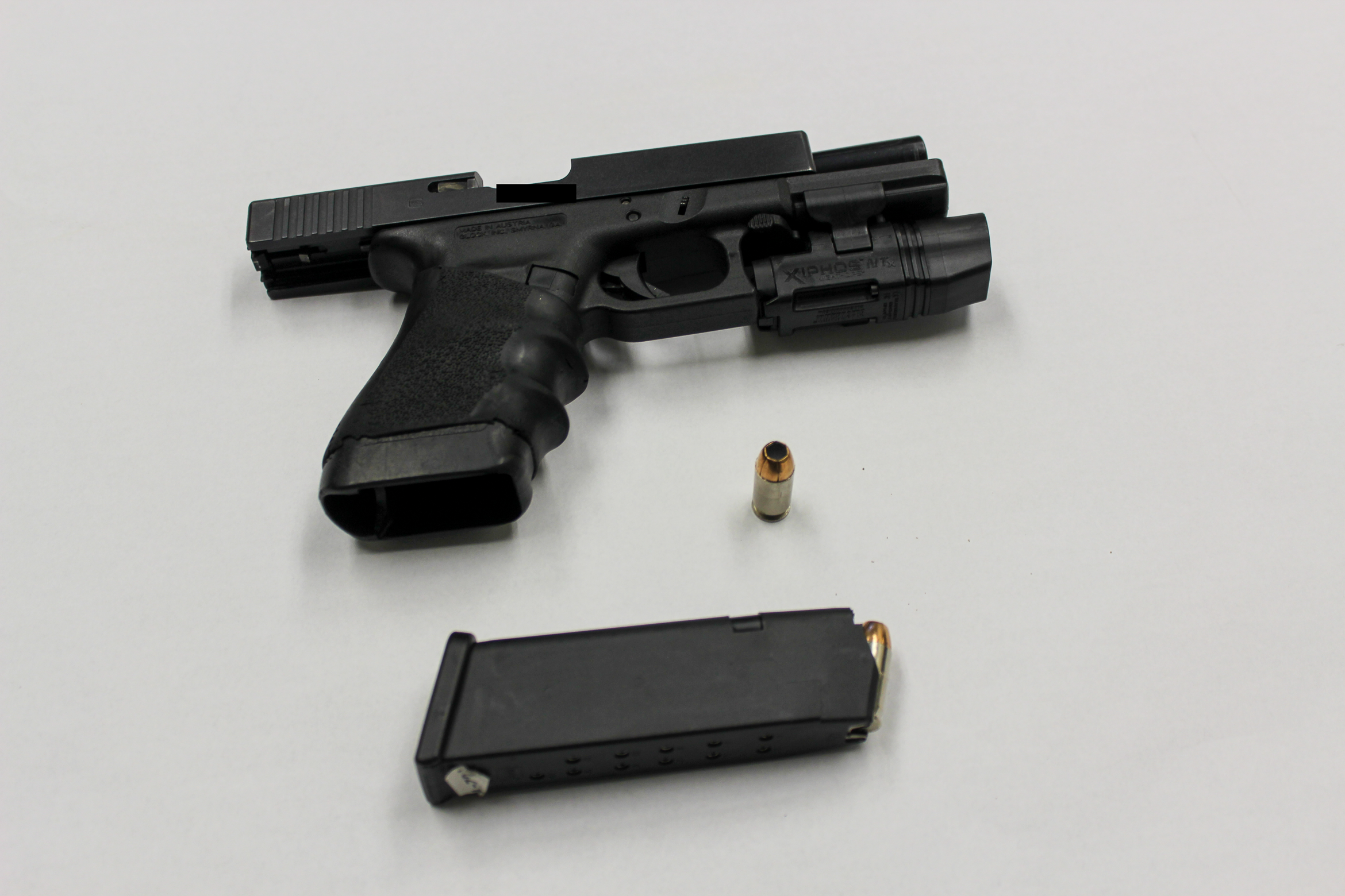 Ofc. McMahon's .45-caliber Glock 21 pistol is seen in an evidence photo after he used it to kill Ronell Foster, a 33-year-old father of two, on Feb. 13, 2018.