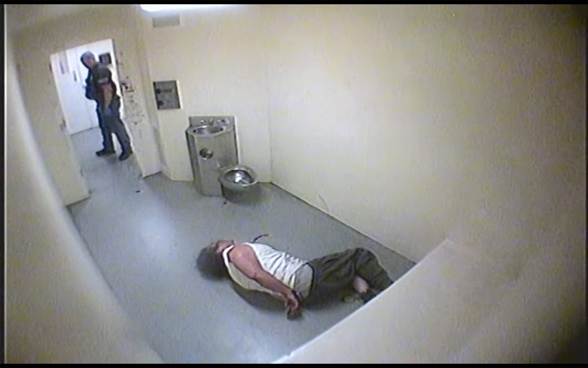 Surveillance video shows then-Detective Kent Tribble repeatedly struck Enrique Cruz, 29, as Cruz sat in a holding cell inside the Vallejo Police Department in 2012. Tribble has since been promoted to lieutenant, and is as a senior member of the department's command staff.