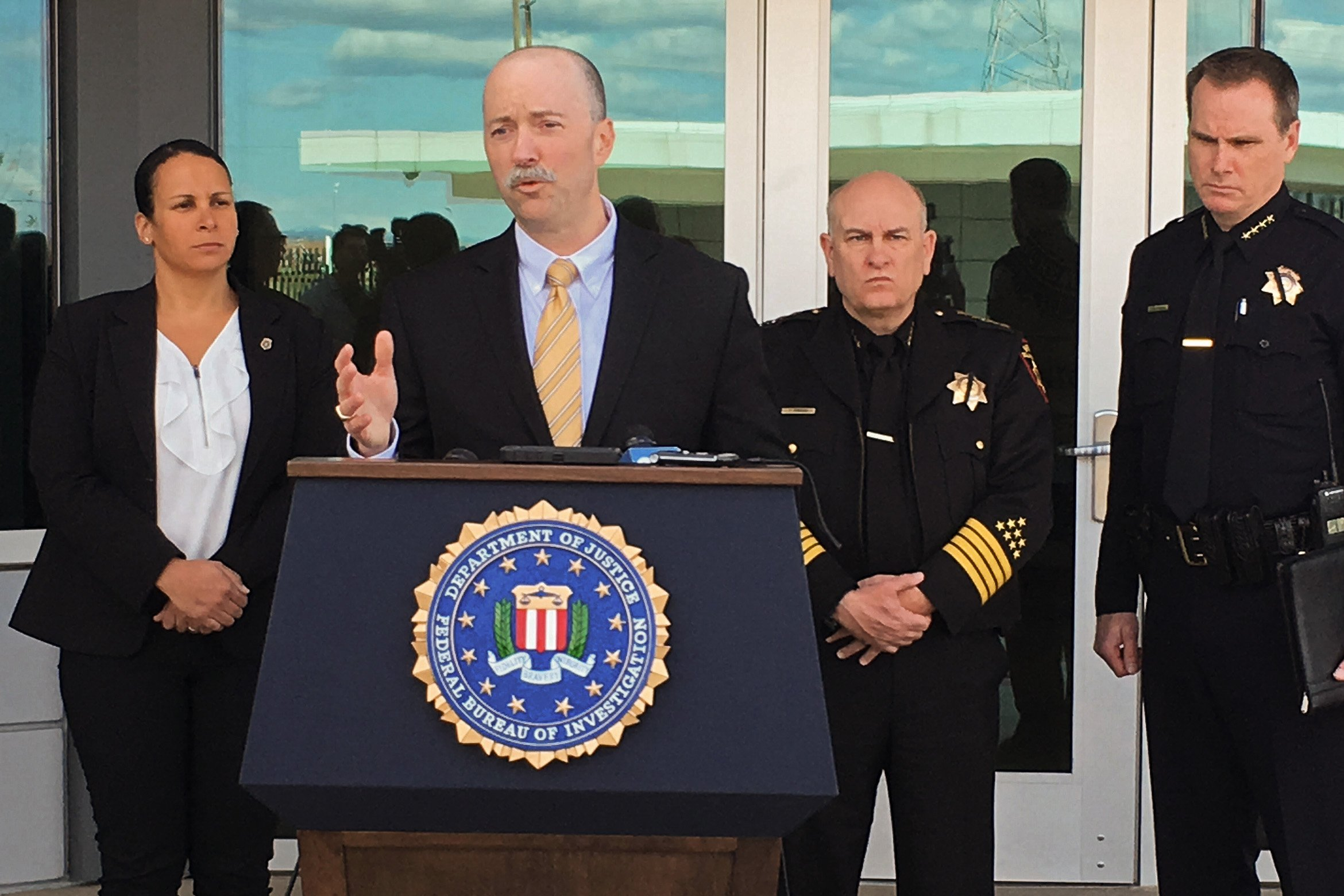 FBI Special Agent in Charge Sean Ragan speaks to reporters at a press conference in Fairfield, Calif. in 2018. Solano County Sheriff Tom Ferrara, second from right, has recently sought to downplay concerns about possible far-right extremism in his agency following an investigation by Open Vallejo.